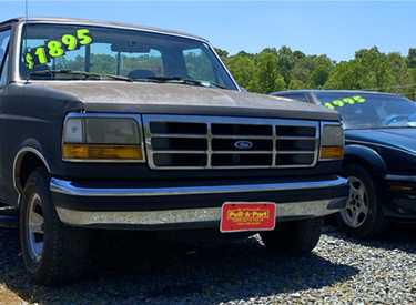 image of a used junk car at Pull-A-Part's local junkyard
